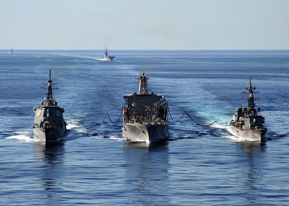 US Navy 101205-N-2013O-034 The Military Sealift Command fleet replenishment oiler USNS Tippecanoe (T-AO 199) refuels the Japan Maritime Self-Defens