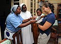 US Navy 110216-N-6984M-001 Hospital Corpsman 2nd Class Cheryl Parker shows photographs of her last visit to a local orphanage to nuns who work ther.jpg