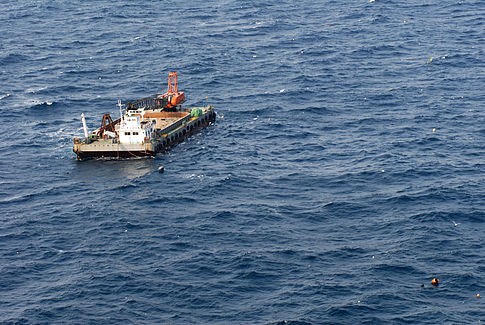 A Japanese barge is seen adrift in the Pacific Ocean. Image: U.S. Navy.