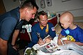 US Navy 110506-N-ZL585-030 Lt. Jason Smith, center, and Hospital Corpsman 1st Class John Mocek visit with young patients at Children's Hospital New.jpg