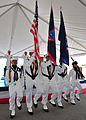 US Navy 110624-N-QY759-044 The submarine tender USS Frank Cable (AS 40) color guard parades the colors during a pierside change of command ceremony.jpg