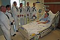 US Navy 110815-N-ZL585-042 Sailors assigned to the Navy Operational Support Center, Indianapolis, visit a patient at the Roudebush VA Medical Cente.jpg
