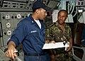 US Navy 110822-N-OV802-022 A Sailor explains his watch standing studies to a Tanzanian navy Capt.jpg