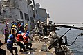 US Navy 110925-N-YZ751-008 Sailors aboard the guided-missile destroyer USS Truxtun (DDG 103) heave a line during a replenishment at sea.jpg