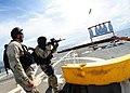 US Navy 111011-N-ED900-950 Operations Specialist Seaman Amanda Gregor fires an M4-A1 carbine.jpg