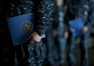 US Navy 111213-N-DR144-360 Newly promoted petty officers wait with their frocking letters to take the stage during a frocking ceremony in the hanga.jpg