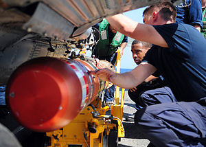 US Navy 111222-N-ZF681-031 Sailors aboard the guided-missile destroyer USS Halsey (DDG 97) load a MK-46 recoverable exercise torpedo (REXTORP) onto.jpg