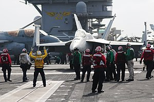 US Navy 111231-N-GZ832-889 An F-A-18E Super Hornet assigned to Strike Fighter Squadron (VFA) 81 is readied for launch on the flight deck of the Nim.jpg