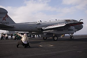 US Navy 111231-N-TZ605-038 Sailors assigned to Electronic Attack Squadron (VAQ) 134 act as final checkers before launching an EA-6B Prowler off the.jpg