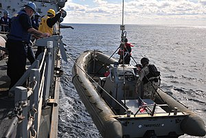 US Navy 120131-N-OP638-031 Sailors assigned to the Arleigh Burke-class guided-missile destroyer USS Porter (DDG 78) haul a rigid-hull inflatable bo.jpg