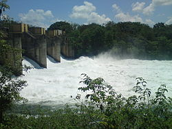 Left-bank view of the dam, with all four spillways open.