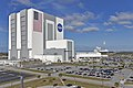 VAB with Falcon Heavy taking off in the background 03.jpg