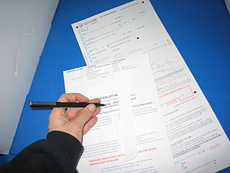 Provisional ballot - A Californian voter fills out a provisional ballot form while voting in the 2004 United States presidential election