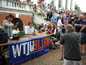 """WTJU - WTJU hosts a live remote broadcast from the """"Rally on the Lawn,"""" where thousands of students, faculty, alumni, and community members had gathered to support recently ousted University of Virginia President Teresa Sullivan."""