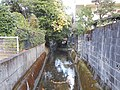 Waterway between houses Hachimankoji Saga.JPG