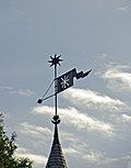 Weather vane on a tower in Kamyanets-Podilsky.jpg