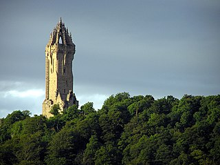 Wallace Monument tower standing on the summit of Abbey Craig, near Stirling in Scotland