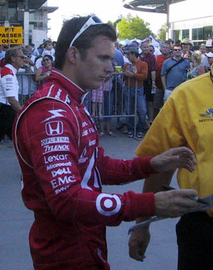 Dan Wheldon signs autographs for fans followin...