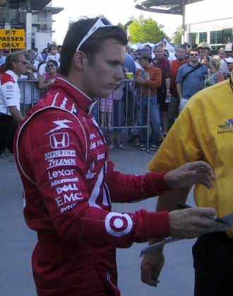 Dan Wheldon - Wheldon signs autographs for fans following Pole Day qualifications at Indianapolis Motor Speedway in 2007.