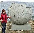 Wikimedia Armenia president Susanna Mkrtchyan's speech near Wikipedia globe at Lake Sevan.jpg