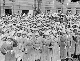 Lilian Barker - Lilian Barker, right centre, surrounded by some of her women workers from the 'danger buildings' at Woolwich Arsenal, May 1918