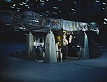 Working on wing of Consolidated Liberator Bomber1a34939v (cropped).jpg