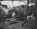Wounded American soldiers are given medical treatment at a first aid station, somewhere in Korea. - NARA - 531364.tif