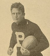 Wylie Glidden Woodruff holding a football in his 1893 Penn football photo.