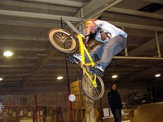 BMX bike - Freestyle rider performing a jump based stunt