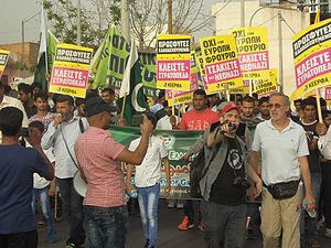 Immigration to Greece - Petros Constantinou, national coordinator of KEERFA (United Movement Against Racism and the Fascist Threat) and Javied Aslam Arain, President of the Pakistani Community of Greece staging a protest in Greece with migrants from Pakistan and Bangladesh.