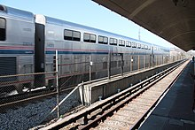 Silver railcars with many windows