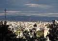 12 Torres del Palau de Victòria Eugènia, al fons la Sagrada Família.jpg