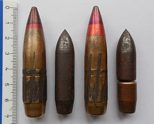 14.5×114mm - B-32 API projectile on the left, hardened steel core aside. Tip is black with a thin red band below. On the right, BZT API-T projectile with dark red tip and a wide red band below; hardened steel core and tracer cup on its right. Both jackets and the tracer cup are made from copper-washed steel. Between the cores and the jackets there would be a layer of lead.