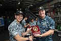 150209-N-DC018-225 Cmdr. Kendall Bridgewater, commanding officer of LCS Crew 104 presents Rear-Admiral Lai Chung Han, Republic of Singapore Chief of Navy, a token gift.jpg