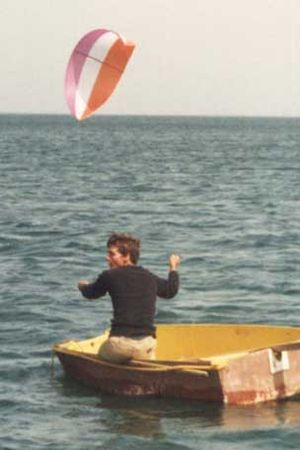 Kiteboating - An early (1984) experimental kite rig being used to pull a boat.