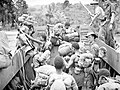 1 New Guinea Infantry Battalion soldiers disembarking a landing craft at Jacquinot Bay on 6 November 1944.JPG