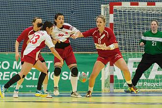 Turkey women's national handball team - Turkey  (white/red) vs Austria at the 2015 World Women's Handball Championship European qualification match.