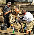 5665 Unsuiting the diver (15512470816).jpg