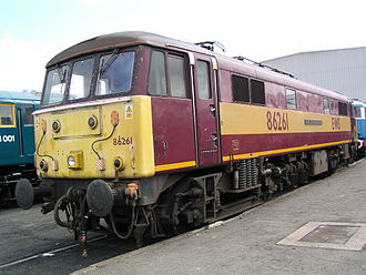 British Rail Class 86 - Class 86/2, no. 86261 'The Rail Charter Partnership' at Doncaster Works open day on 27 July 2003. This locomotive was owned by English Welsh & Scottish, whose livery it carries. It was primarily used on parcels trains, and was also hired to Virgin Trains. It was withdrawn from traffic in 2002, and was scrapped in 2004.