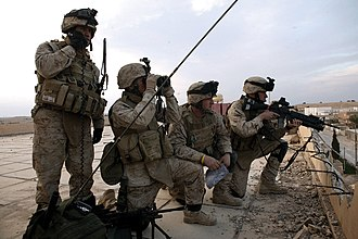 Air Naval Gunfire Liaison Company - An ANGLICO team operates from a rooftop during the Iraq War.