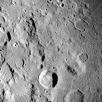 Kant (crater) - Kant (lower center) and Zöllner (upper left) from Apollo 16. Mons Penck is also visible to the right, below center. NASA photo.