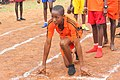 A Female Athlete. Junior female student as she prepares for a 200 meters race.jpg
