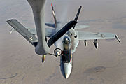 A U.S. Navy F-18E Super Hornet receives fuel from a KC-135 Stratotanker over Iraq before conducting an airstrike, Oct. 4, 2014. The aircraft are supporting operations against the Islamic State of Iraq and the Levant, or ISIL