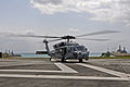 A U.S. Navy MH-60S Seahawk helicopter, assigned to Helicopter Sea Combat Squadron (HSC) 25, prepares to take off from a landing pad at White Beach Naval Facility, Okinawa, Japan, March 14, 2014 140314-N-BJ178-252.jpg