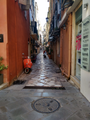 A narrow street (called Kadouni) in the Old Town of Corfu.png