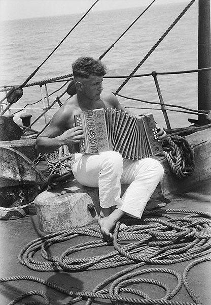 File:A sailor and his accordion onboard the Parma.jpg