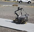 A staged Implemented Explosive Device is removed from the scene by deputies from the San Bernardino County Sheriff's Office using a remote controlled robot during training exercises aboard Marine 160726-M-DU308-001.jpg