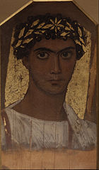 A young man in a gold wreath