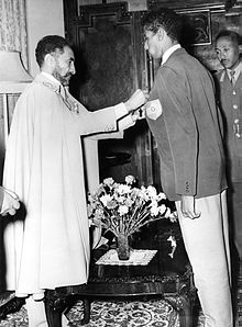 Haile Selassie awards the Star of Ethiopia to Abebe Bikila in the Green Salon of the emperor's palace.