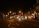 Addington Road, Selsdon CR2. Looking northwest, down Selsdon's main shopping street, its Christmas decorations still intact.
